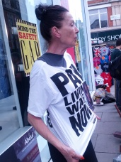 "Katherine Hamnett with one of her signature political t-shirts (""Pay Living Wages NOW!"")"