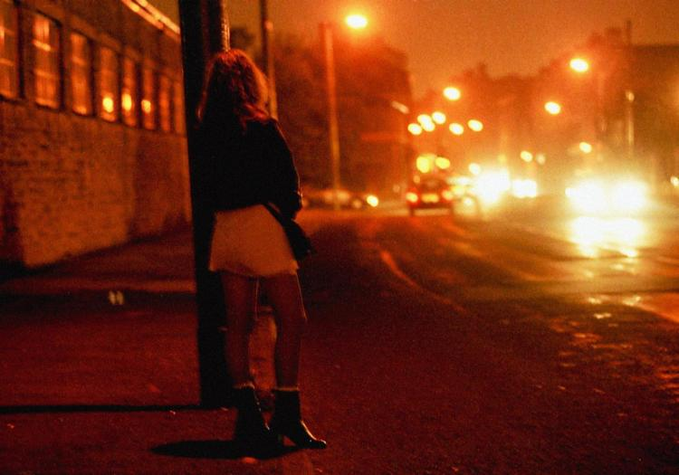 """PA file photo dated 29/07/1996 of a prostitute in the red light district of Bradford, West Yorkshire. PRESS ASSOCIATION photo. Issue date: Saturday March 10, 2007. A conference today will discuss the """"urgent"""" issue of legal protection for prostitutes and victims of rape and racism. The Rape, Race and Prostitution Conference, in London, will examine how women could be better protected by changes to the justice system. See PA story SOCIAL Prostitution. Photo credit should read: Paul Barker/PA Wire"""